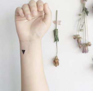 Black triangle by Tattooist Flower. #minimalist