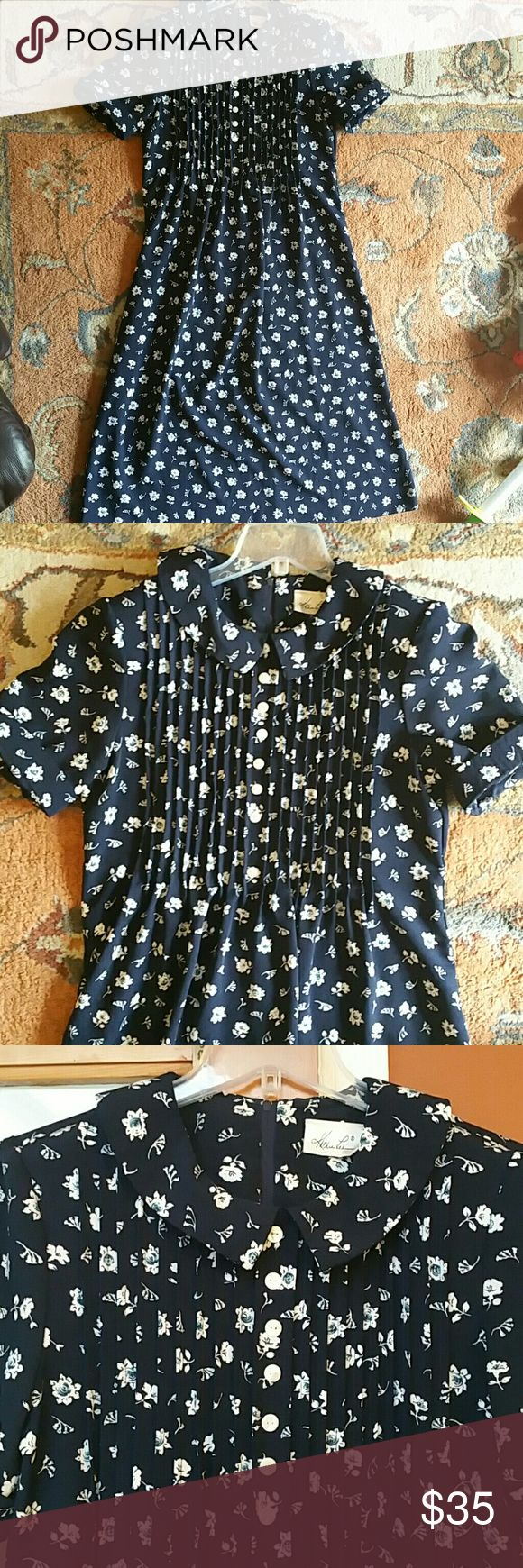 Vintage floral dress size 10 navy and cream Stunning floral peter oan collar with pleats and buttons up top. Long midi or maxi for a short person.  Zips up in back. Polyester no flaws. Vintage  10 Dresses