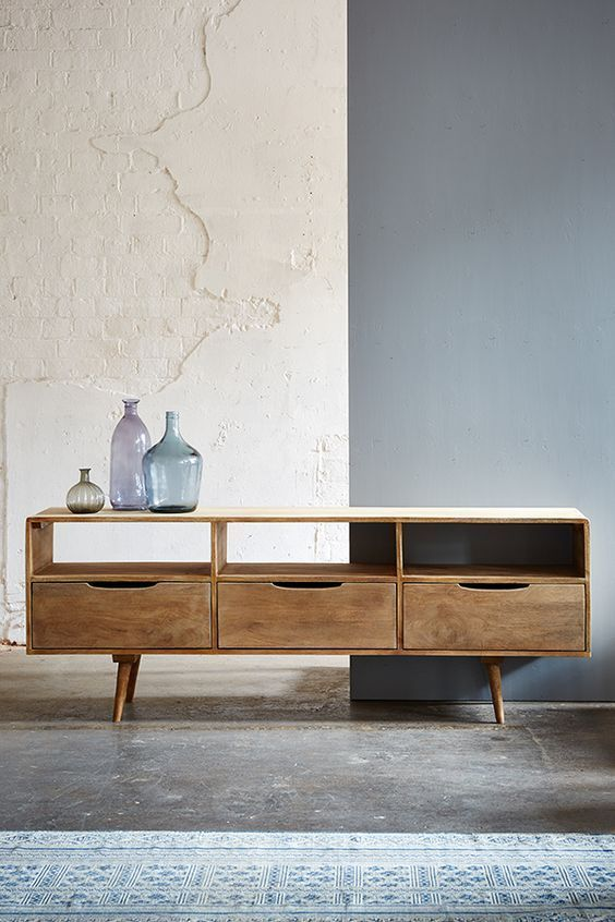 This modern take on an old danish design would make great media storage, sit your tv on top and hide all the ugly bits in the drawers