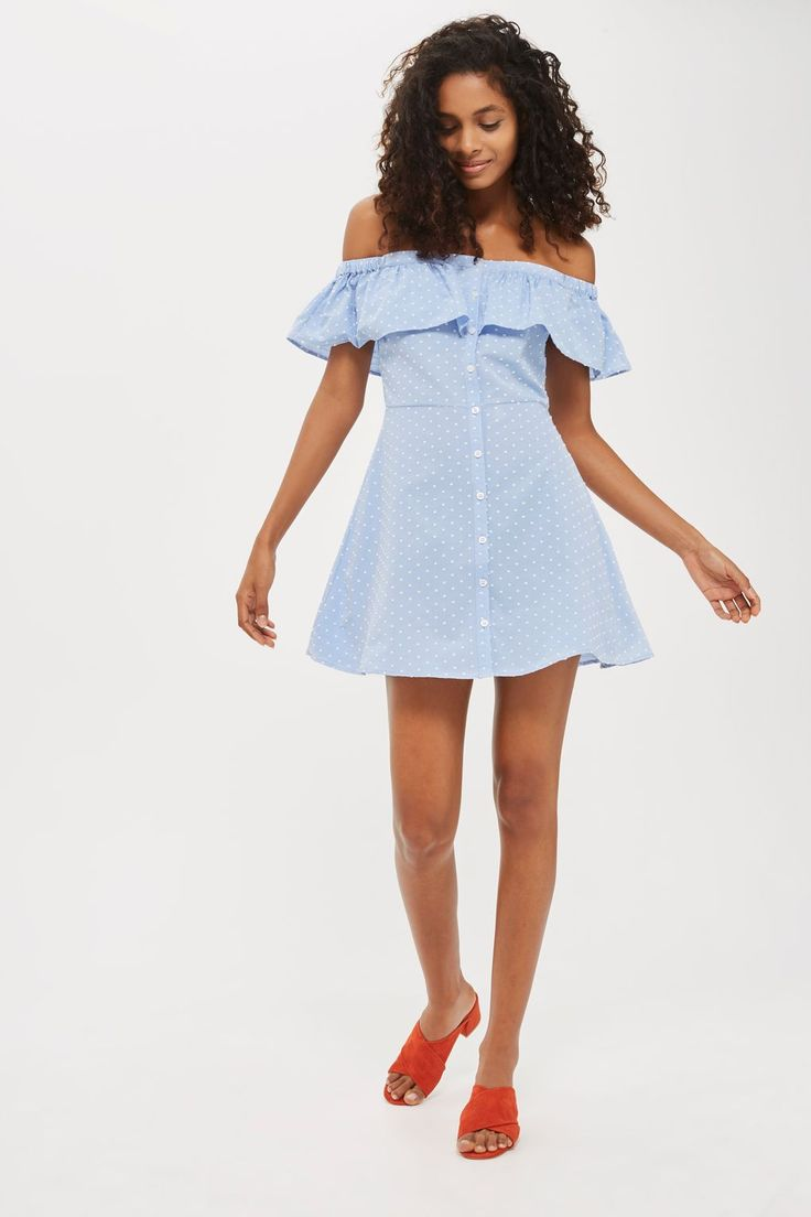 We love the carefree feel of our icy blue polka dot dobby dress. Falling above the knee, this airy cotton-blend piece boasts an on-trend bardot neckline, buttoned front, and a fun textured frill. Complete the look with pastel heels and a mini tote.