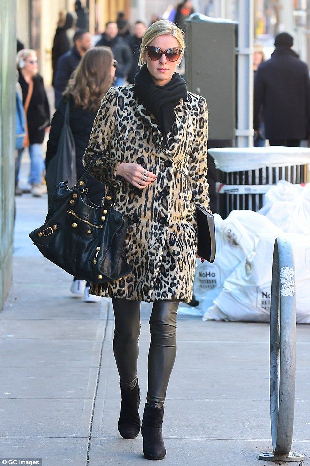 Bundled up: The heiress, 33, paired the coat with gray PVC skinny leggings and black ankle...