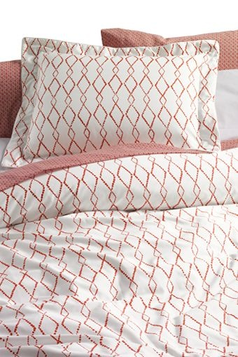 A pop of dark orange would look really good in the guest room - maybe just the shams - Lands End- $19.99