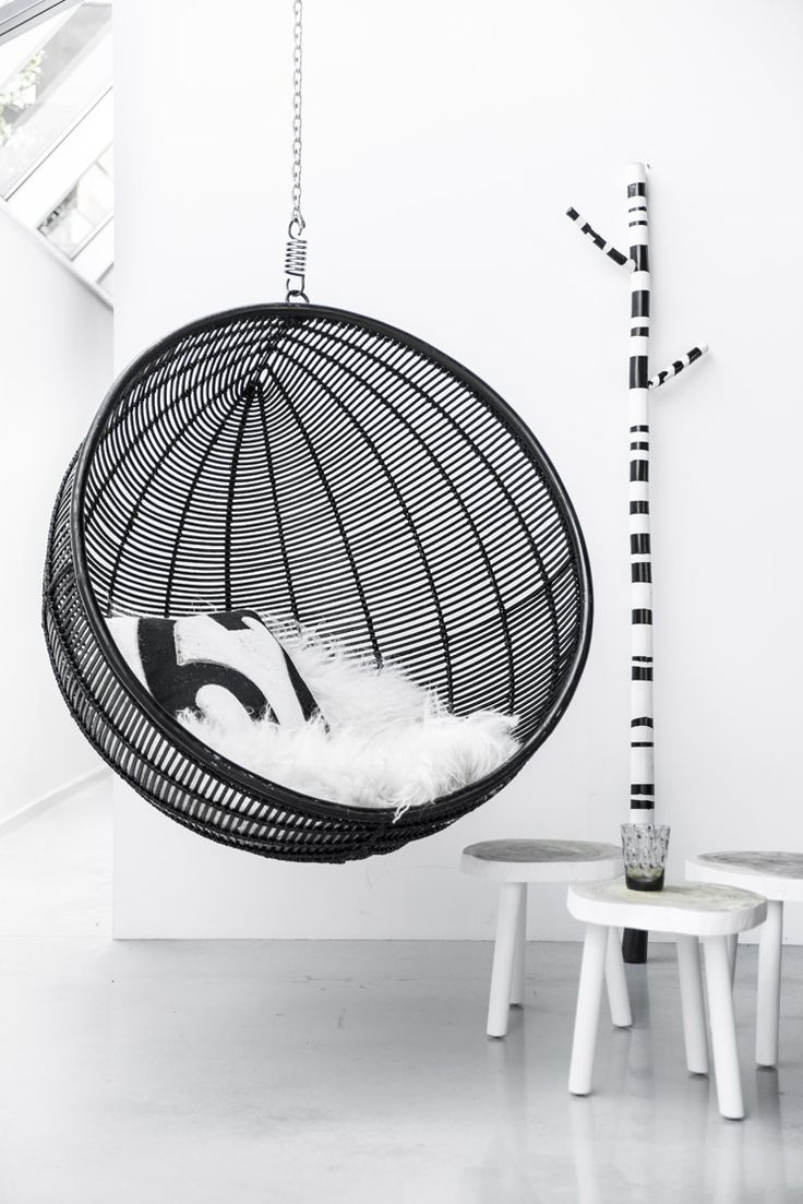 black rattan hanging bowl chair | from HK Living 2014 catalogue, by Paulina Arcklin http://www.bykoket.com/all-products.php#chairs-dining-chairs