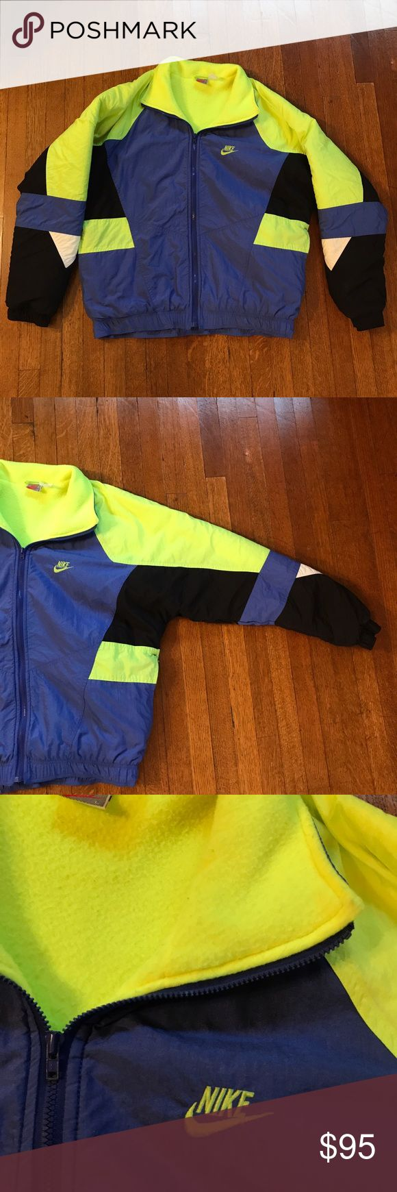 Vintage Nike Coat Vintage Nike coat in size men's large. Very good vintage condition with no stains or holes. Only flaw is the light piling on the inside fleece as pictured. Features two zipper front pockets. Nike Jackets & Coats