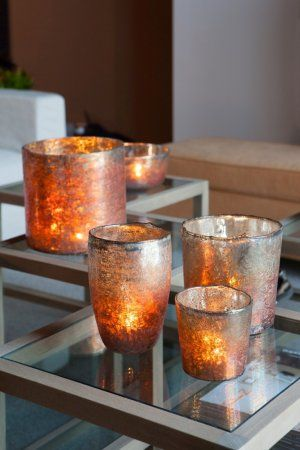 Bold oranges and even dark purples can complement bronze and copper hues in darker spaces, brining the room together.
