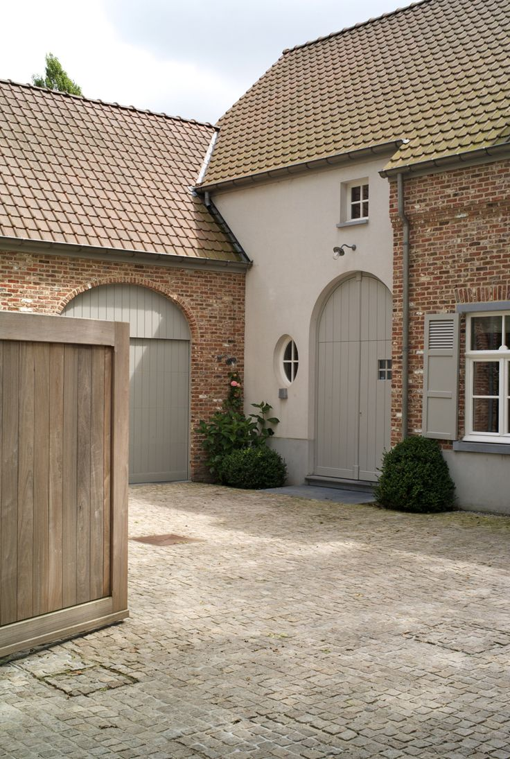 Exterior detailing - French grey woodwork, soft clean white render and red brick colour palette
