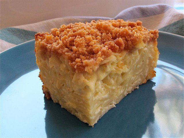 This moist, creamy Vanilla Noodle Kugel is made with pudding and covered with a crunchy cookie topping. Perfect for potlucks. Kosher, Dairy.