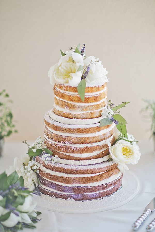 Lavender-infused ombre naked cake adorned with white peonies and sprigs of fragrant lavender