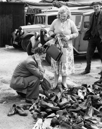 Bob Collins -- Second-hand shoes for sale at a market in the East End: c. 1948 -- High quality art prints, framed prints, canvases -- Museum of London Prints