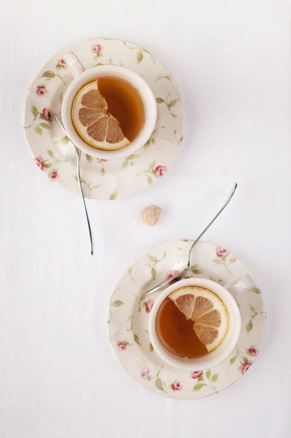 Lemon slices artfully arranged in teacups... { #lemontea }