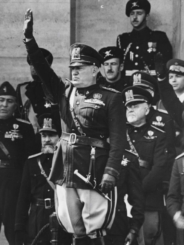 """scandinavicae: """"Benito Mussolini saluting as 70,000 women march past during a Fascist rally, Rome, May 31st 1939. """""""