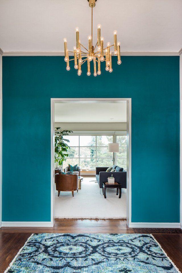 Wohnideen für ein extravagantes Ambiente-lackierter Parkettboden-Türkisfarbene Wände