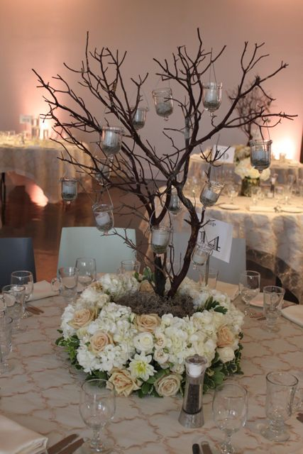 Manzanita branches with hanging votives and lush floral