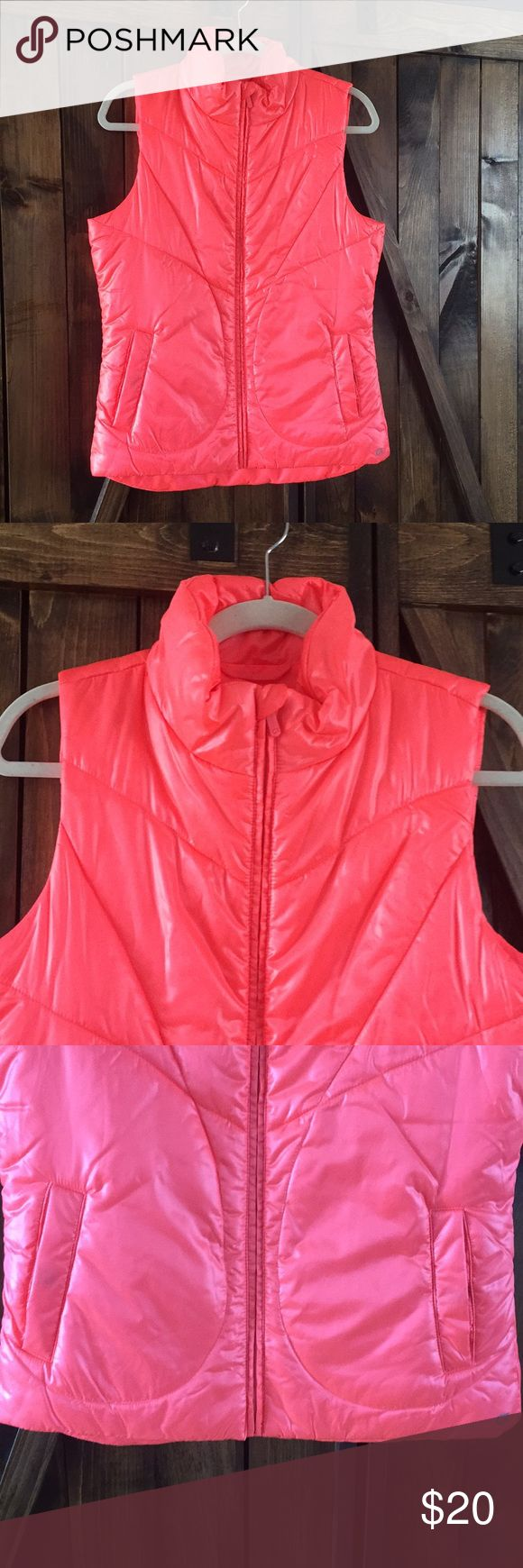 Ladies Small GAP FIT Winter VEST This is a great looking vest by GAPFIT. It is a size small. It is a great orange/pink color. It has a zipper down the front with two pockets. It is in excellent condition with no stains or holes. GAP Jackets & Coats Vests