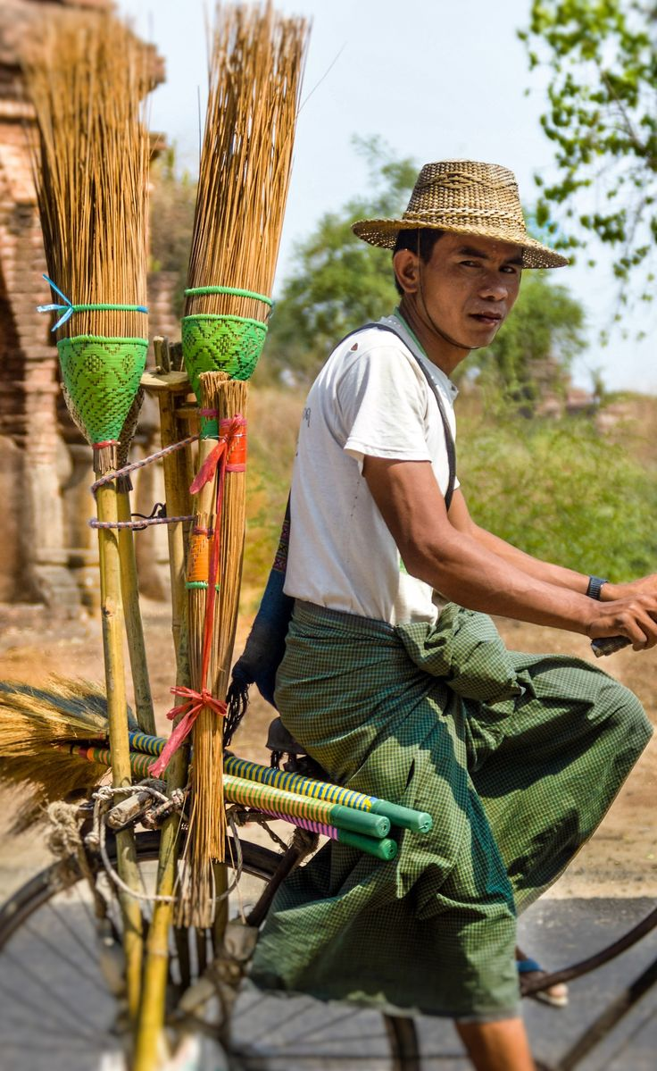 Peddaling down the road selling brooms in Bagan #hsipaw #myanmar #burma