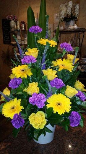Yellow and mauve A line arrangement in a ceramic pot