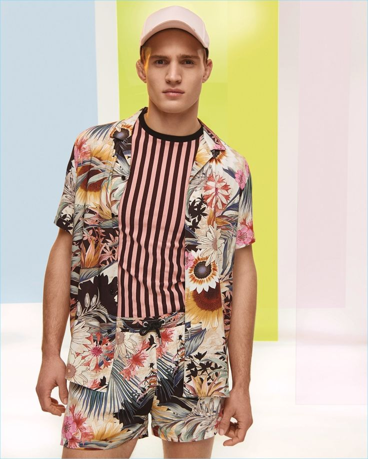 Embracing prints, Julian Schneyder reunites with River Island to model its high summer collection.