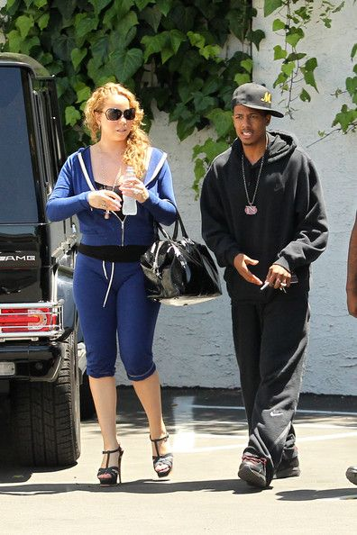 Mariah Carey Photos Photos - Mariah Carey, wearing stiletto heels and blue sweats, is accompanied by husband Nick Cannon to a medical building in LA. The 40 year old singer recently renewed her wedding vows with Cannon in front of about 100 guests at their home in Beverly Hills on May 3rd. - Mariah Carey and Nick Cannon at a Medical Building