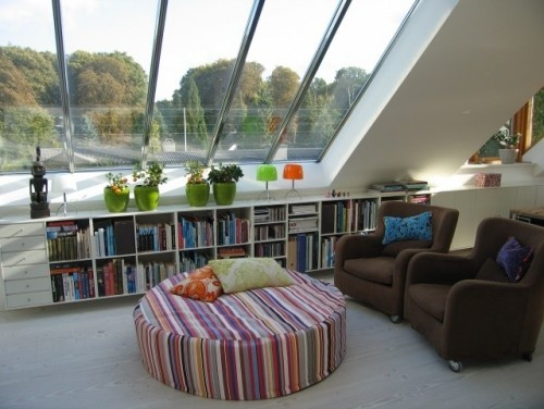 In this attic, half the roof became a skylight, making the room feel big and loftlike despite the low ceilings.