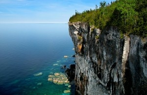 Bruce Peninsula National Park - Ontario  Situated on the northern tip of the Bruce Peninsula, between Georgian Bay and Lake Huron. The spectacular park, with a size of 155 square kilometers at the end of the Niagara Escarpment, consists out of limestone cliffs, caves and underground streams, and ancient forests with some of the oldest trees in Canada. You may even discover rare orchids. A great park for hiking or sea kayaking in the Water's of Georgian Bay.