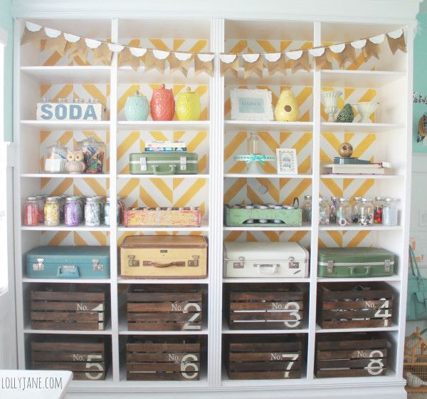 Craft Room organization.  Wooden Crates, Mason Jars and vintage suitcases.