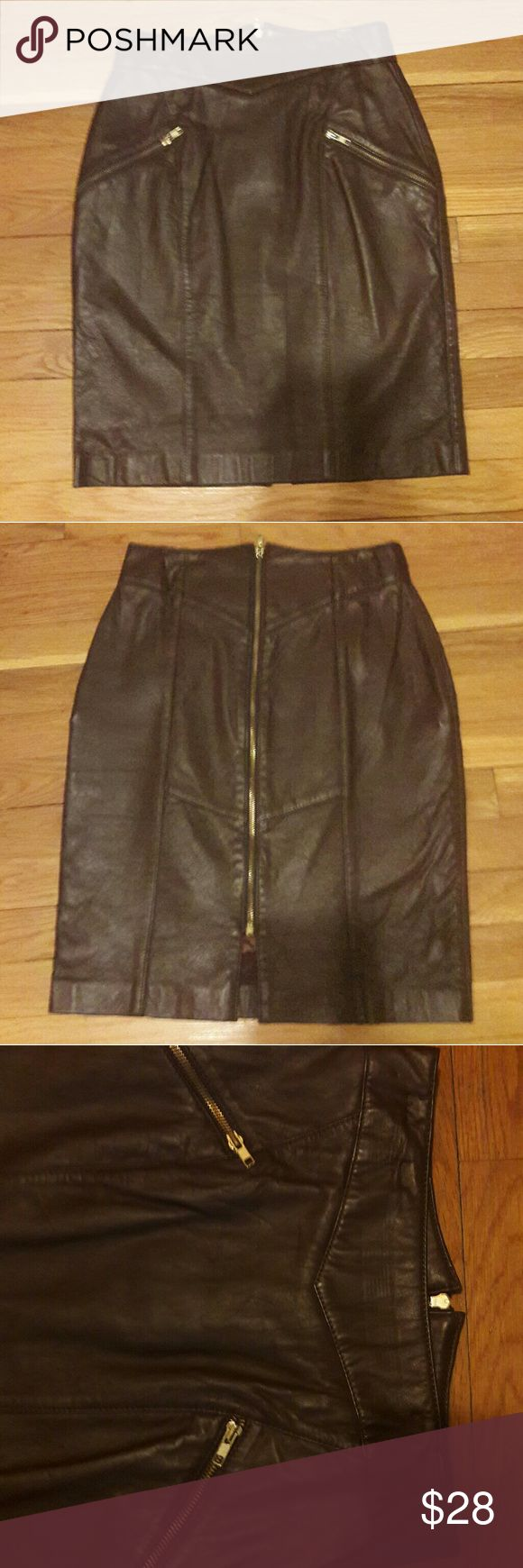 """Vintage buttery leather skirt zip coffee color This is a soft, beautifully fluid vintage leather skirt with a sexy full back zip.  I am selling a lot of leather skirts, but this one is the cream of the crop - the leather is thicker, lush, clearly higher quality than the others.  Fully lined with two slant zip pockets.  Label says simply """"Claudel."""" Measurements: waist 26"""", length 21"""".  Rough estimate womens size 2-4. There are some small indentations on waist of skirt from previous owner…"""