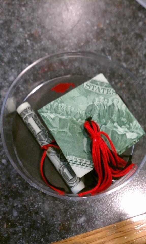 Graduation gift idea - money folded like cap and diploma.  Cute idea!