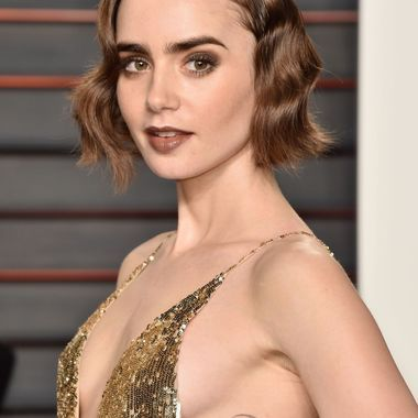 Lily Collins at 2016 Vanity Fair Oscar Party in Beverly Hills