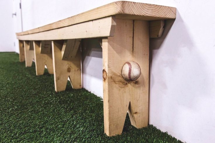 Manon Prince Interiors designed and constructed a custom dug out bench that sits solidly in a baseball academy. Love the baseball touch on the sides!