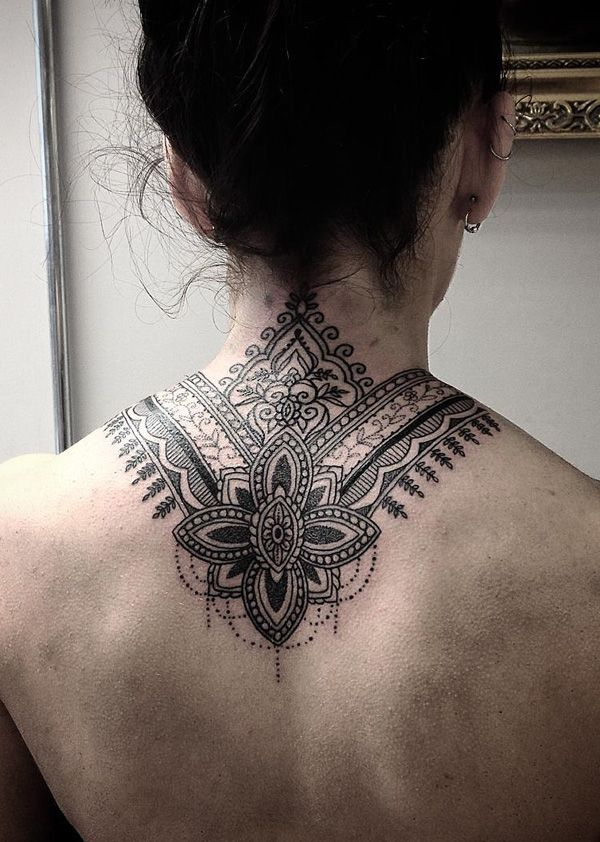 Mandala nack tattoo - Wonderful looking mandala neck tattoo. The tattoo hugs begins from the base of the neck and stretches out to hug the back,