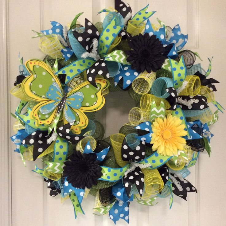 """""""Butterfly Wreath""""...was specially made for Sharon Mauriello. ($100) It is on a white wire frame, moss green deco mesh, yellow/white and turquoise deco mesh curls, 2.5"""" black/white polka dot ribbon, 2.5"""" turquoise/white polka dot ribbon, 1.5"""" lime/turquoise polka dot ribbon, 1.5"""" green/white chevron ribbon, butterfly wood embellishment, black and yellow silk gerber daisies.  If interested, please message me. Thank you!"""