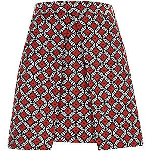 Red geo jacquard wrap front mini skirt