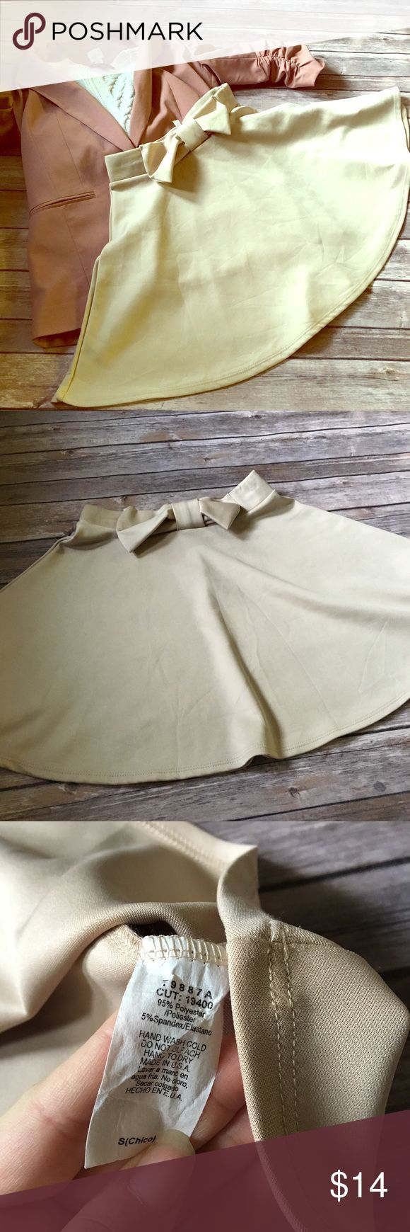 Chocolate Beige Bow Top Skater Skirt Super cute and fun mini skater skirt with bow on waistband. Not lined but not see through. Cream color goes with so many tops! Elastic waistband, and material does have stretch. Waist while not stretched and length measurements pictured. EUC no flaws. chocolate Skirts Circle & Skater