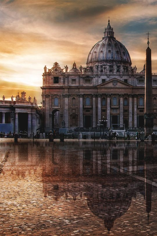 St. Peter's Basilica looks gorgeous in this amazing photograph w/ a cloudy sky. This iconic classical architecture is a must-see on any trip to Rome!