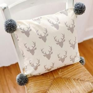 Our deer throw pillow with gray pom poms is perfect for your nursery glider or bay window! Throw Pillows in the nursery can tie together your baby bedding, curtains, rug and any other design elements in the room. Connect the dots in the nursery by brightening up a chair, adding a pop of color, giving a lift to a bay window or introducing a new trend with a fun and whimsical nursery pillow. Pillows are one of the easiest and one of the least expensive ways to add color & pattern to you...