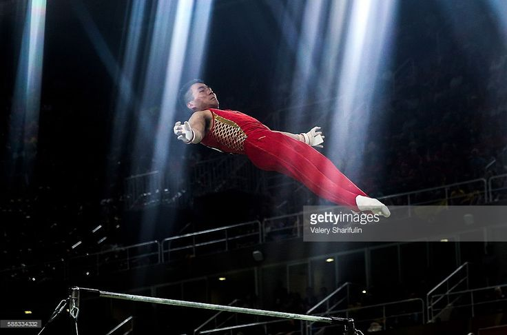 Shudi Deng of China performs his horizontal bar routine during the artistic gymnastics men's individual all-around final at the Rio 2016 Summer Olympic Games, at the Rio Olympic Arena. Valery Sharifulin/TASS (Photo by Valery Sharifulin\TASS via Getty Images)