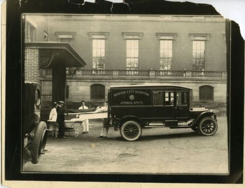 """Taking patient from ambulance"" at Boston City Hospital, November 11, 1928. Boston City Hospital collection (7020.001) For more digitized images from this collection, see here"