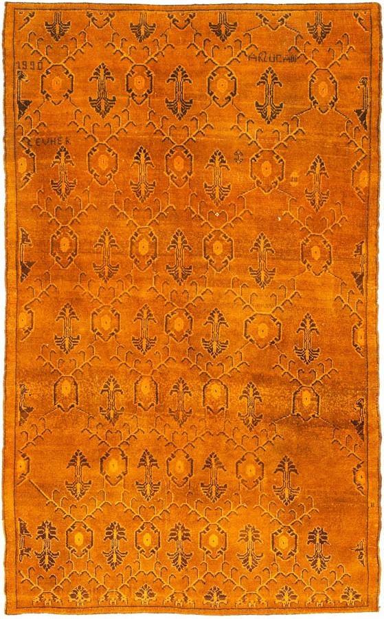 yellow over dyed rug