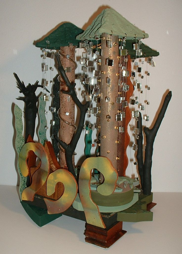 """Rain Forest""  Mixed media sculpture depicting the motion of falling rain. Artist: Theresa Villani."