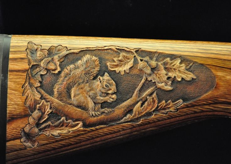 Custom hand carved gun stock by robin coalson with deer