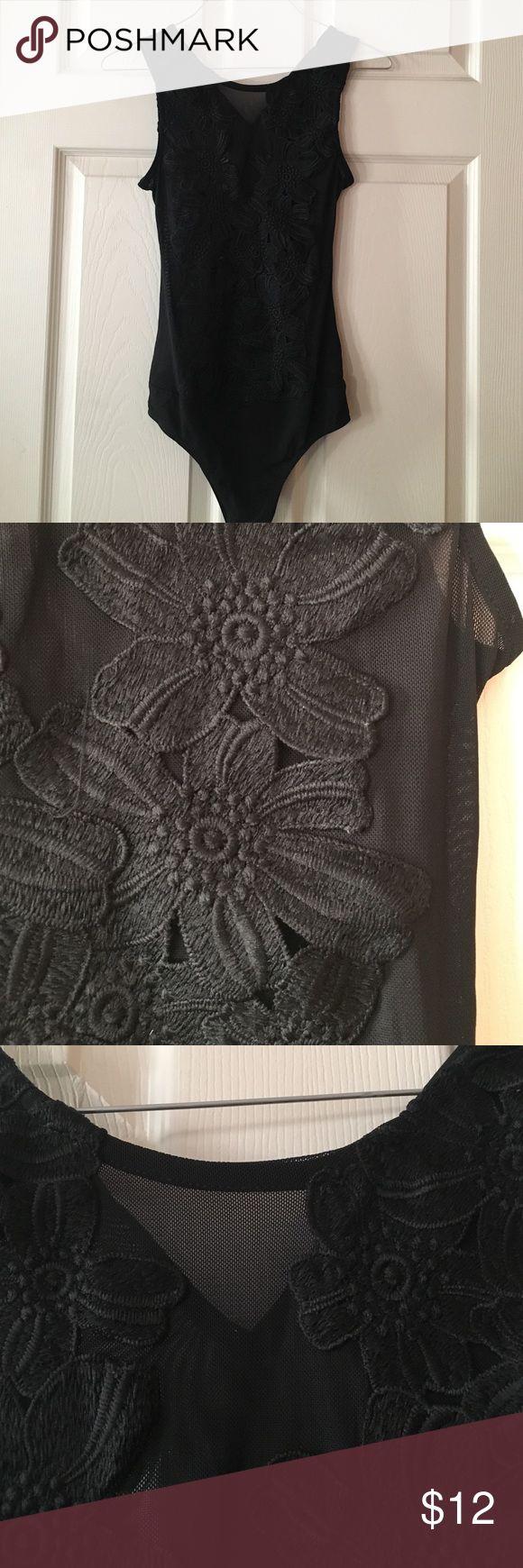 Mesh bodysuit Black mesh bodysuit. Flower design throughout the front of the bodysuit. New never worn Tops Blouses