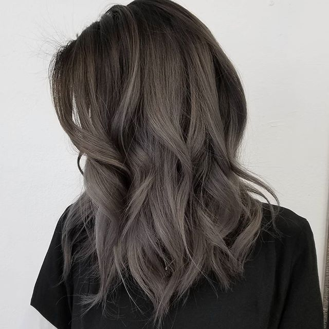 Dark grey ombré hair color, medium wavy hairstyle