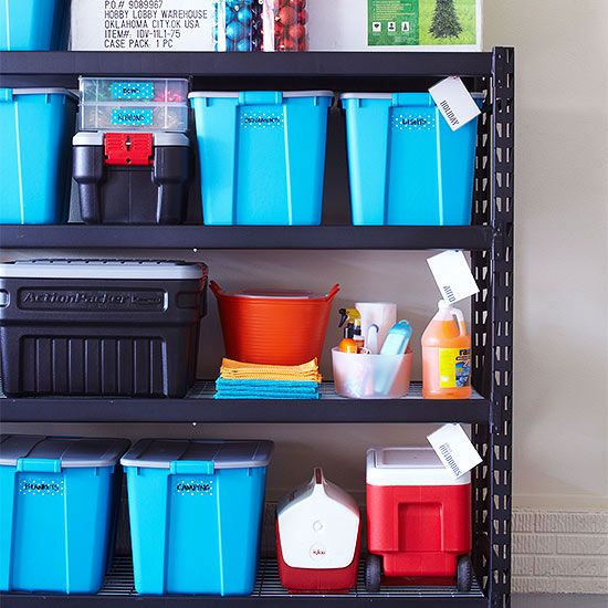 Sturdy metal stationary shelving is a garage staple. This 24-inch-deep version is ideal for holding large plastic bins of holiday decorations. Be sure to label each bin so things don't get lost. Decorative duct tape and a permanent marker do the trick in this garage.