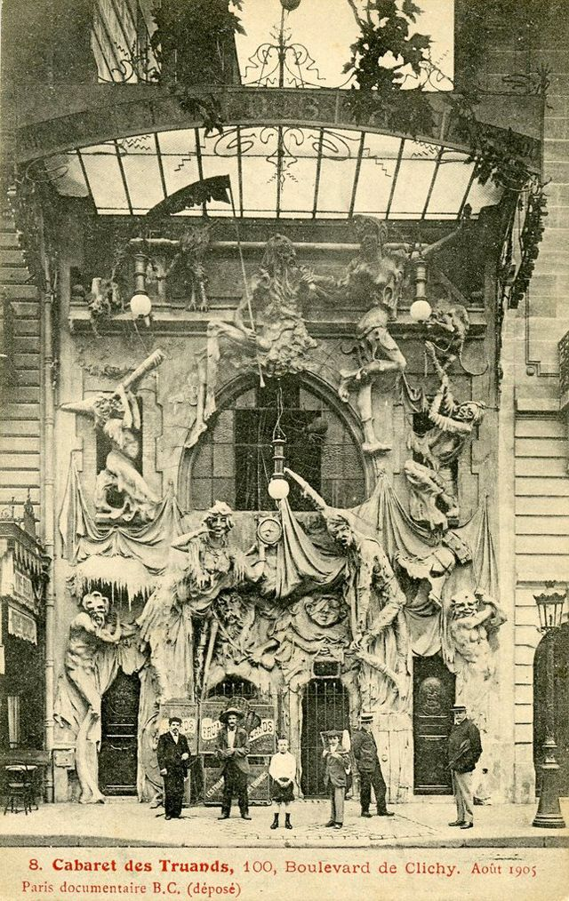 « LA TAVERNE DES TRUANDS », 100, BOULEVARD DE CLICHY. (1910) Le cabaret des Truands et le music-hall de l'Araignée, situés à Paris au 100, boulevard de Clichy. La façade impressionnante de ce cabaret a disparu pour laisser la place au théâtre des Deux-Anes. (from golem13.fr)