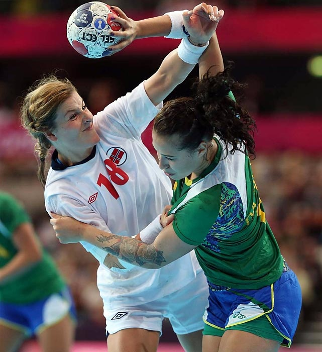 Linn-Kristin Riegelhuth Koren of Norway defends during the Norway-Brazil handball quarterfinals.    Read more: http://sportsillustrated.cnn.com/multimedia/photo_gallery/1208/olympics-london-2012-day-11/content.10.html#ixzz22uk5xGtk