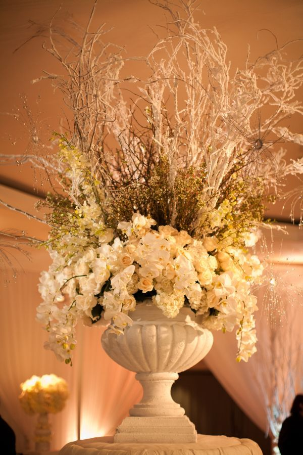 One huge urn on each sidevofvstage w hydrangeas in dress color and another color?