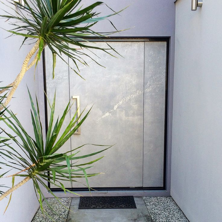 Silver pitted Marmorino front door in New Farm QLD
