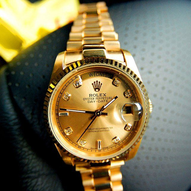 Gold Rolex Day Date President II Watch