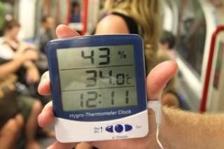 London heatwave: Tube passengers sweat it out in hot weather as temperatures exceed 34°