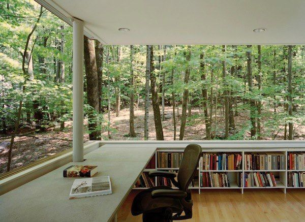 Oh, this is beautiful - imagine that, a workspace on the edge of a forest, all your favorite books within arm's reach.